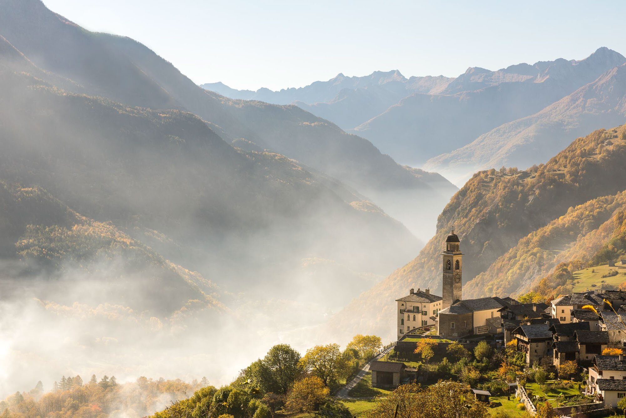 Smoke hangs over Soglio in the Bergell, as during the chestnut harvest the leaves and the empty chestnut shells are burned. Copyright by: Switzerland Tourism