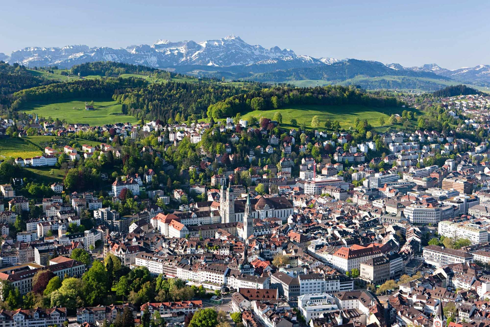 St. Gallen in Eastern Switzerland, labelled world cultural heritage by UNESCO. In the background the Alpstein mountain chain with the Saentis (2502 m). Copyright by: Switzerland Tourism