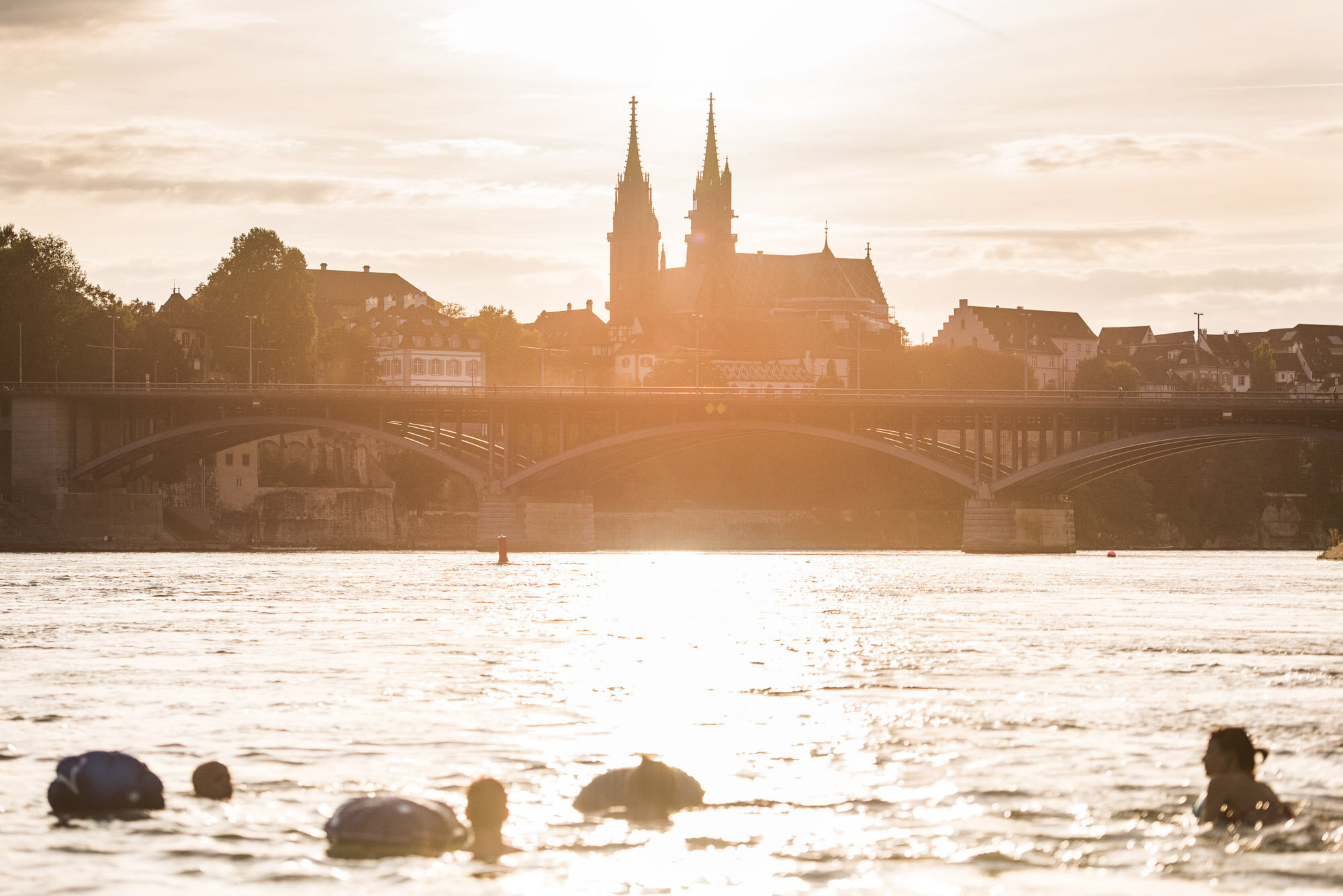 Basel is one of the few places where you can swim in the river right in the middle of the city. In summer, the Rhine attracts the whole city. Copyright by: Switzerland Tourism