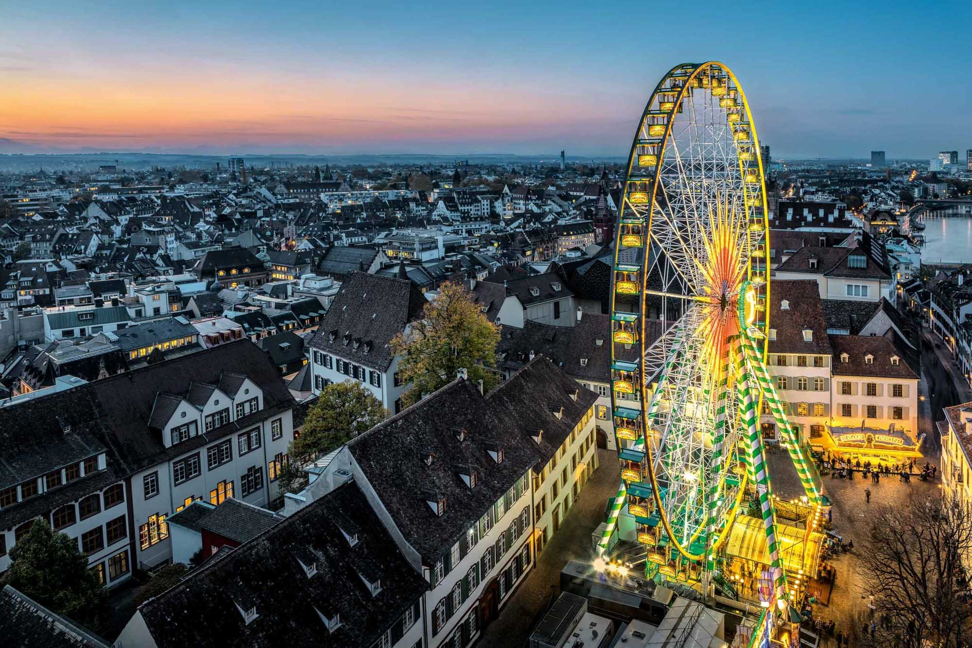 Autumn fair in Basel with the Ferris wheel on the Muensterplatz. Copyright by: Switzerland Tourism