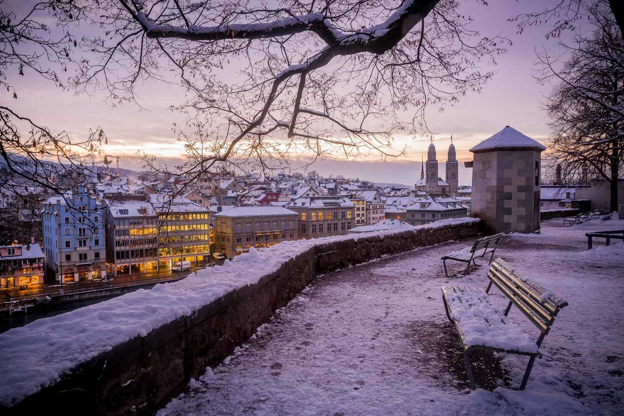 View from Lindenhof on Limmatquai and Grossmuenster in winter with snow, Zurich. Copyright by: Switzerland Tourism