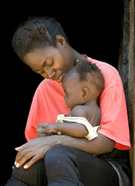 Georgina Maria Domingos cares for her daughter Maria Costa at their home in the Cacilhas village near Huambo, Angola. Photo by Mike DuBose, United Methodist News Service.