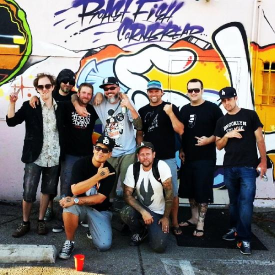 Artists in front of OG Slicks amazing piece.