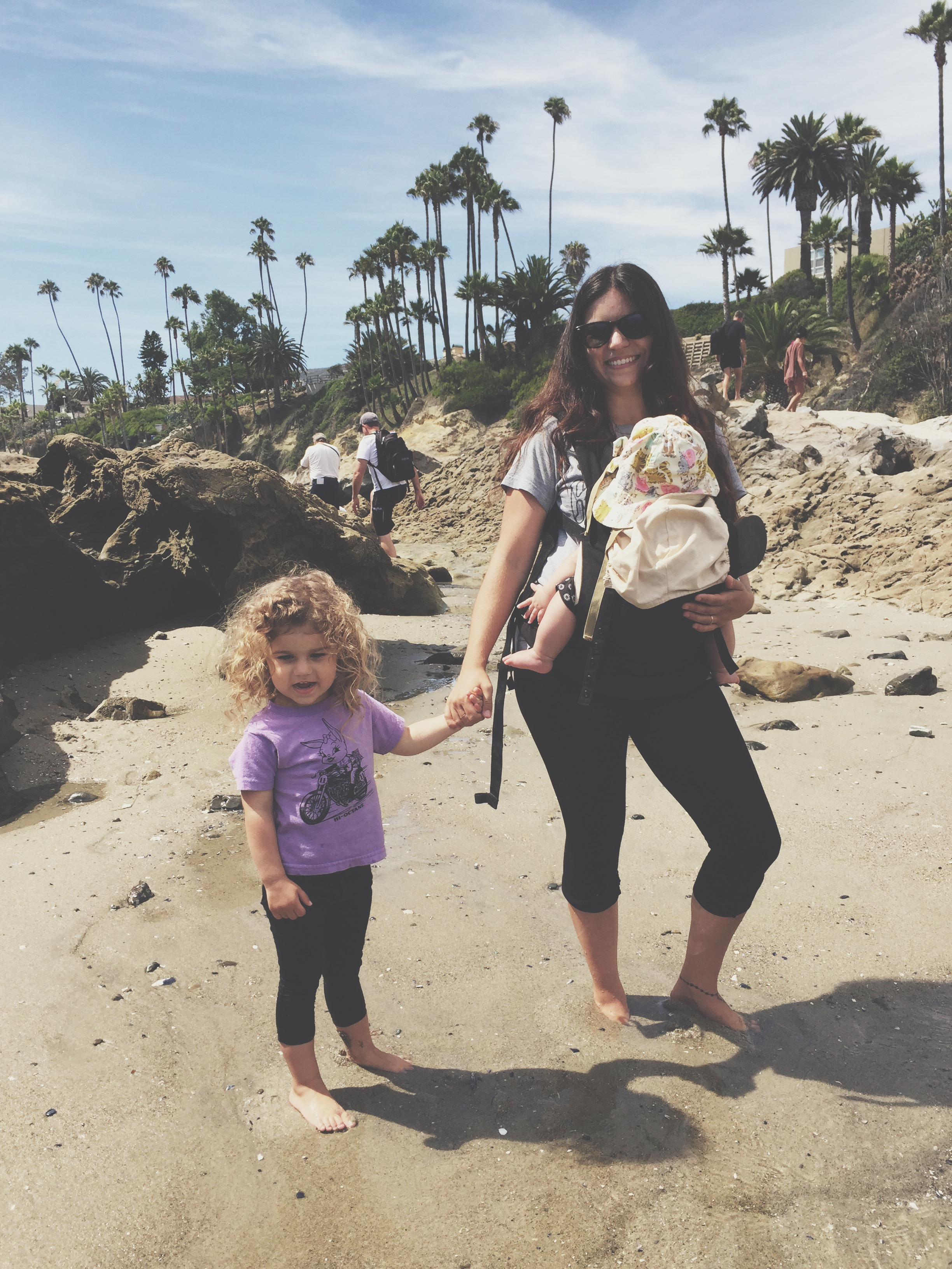 laguna beach with baby in ergo