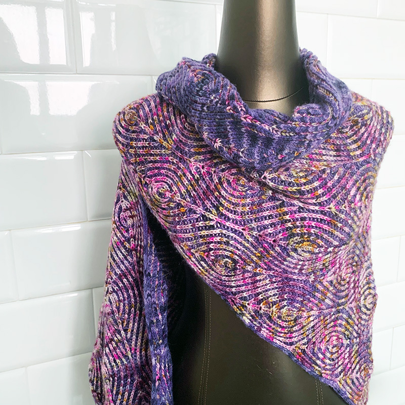 - Myriad Brioche ShawlInspired by ripples on the surface of water, this triangular two-color brioche shawl was designed during the rainy season in Singapore where I was able to watch the patterns of rain on water every single day.Pattern available here on Ravelry.