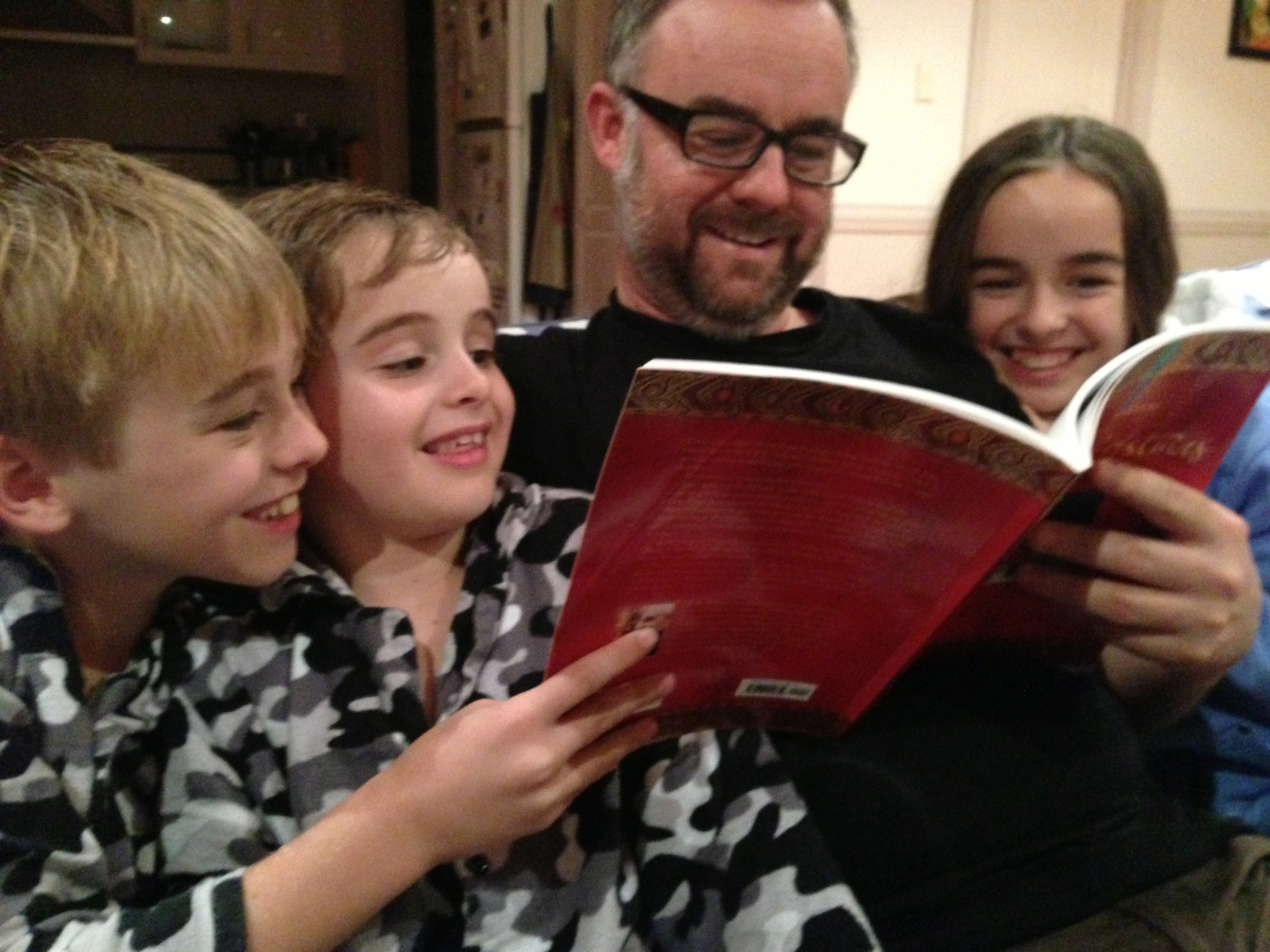 Dan reading J.R.R Tolkien's 'Letter from Father Christmas' to three of his children.
