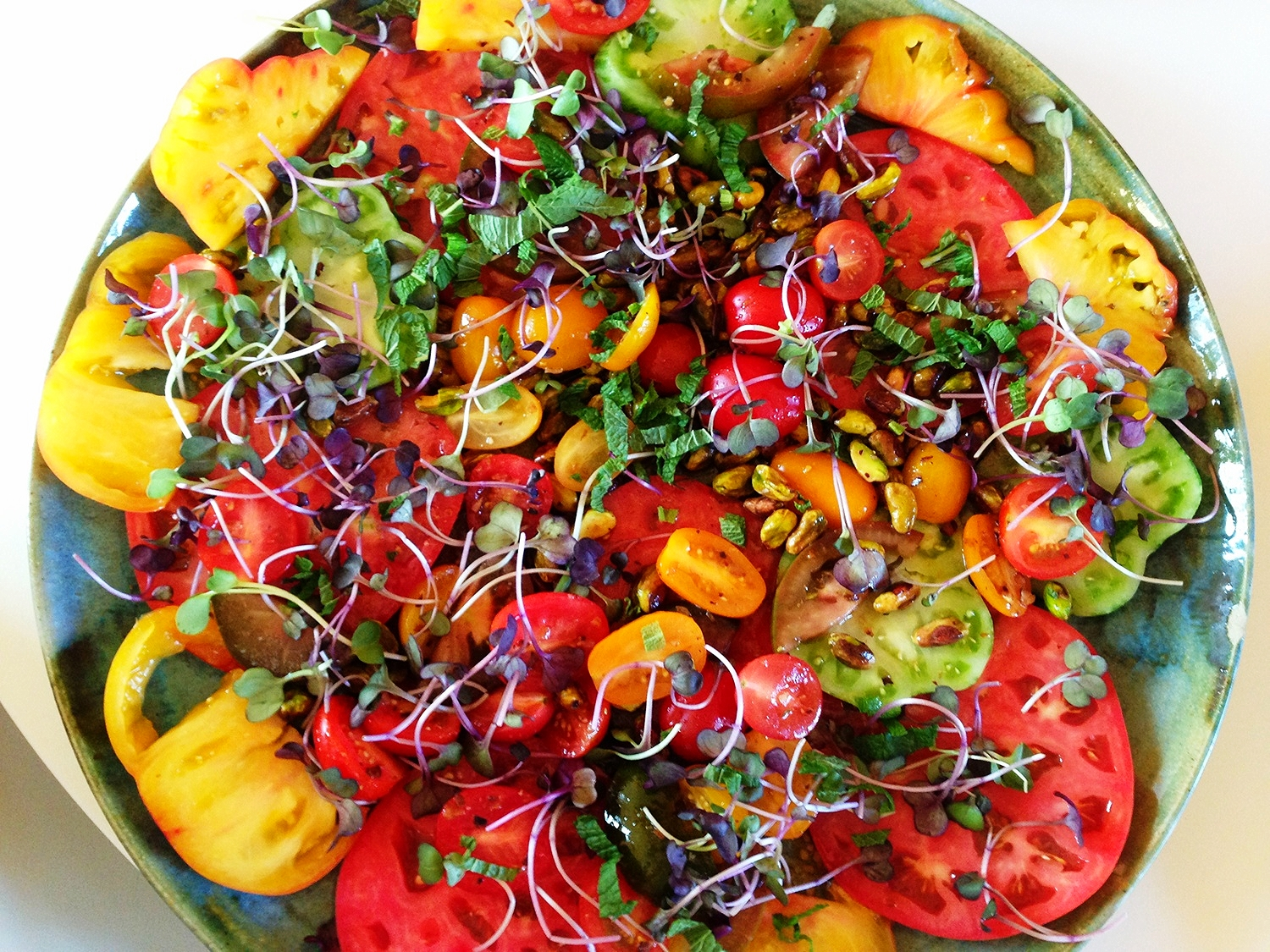 Heirloom tomato salad, broccoli sprouts, pistachios, and garden herbs