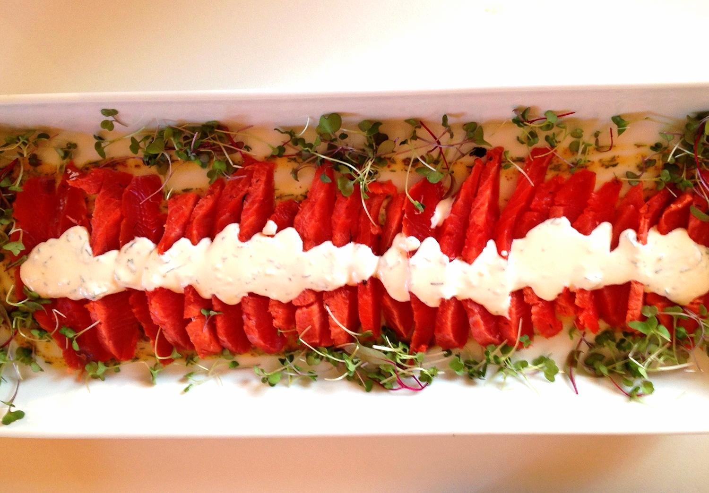 Cured Coho salmon gravlax with horseradish cream and microgreens