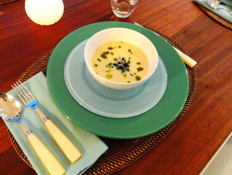Cold corn soup with pickled blueberries and basil oil