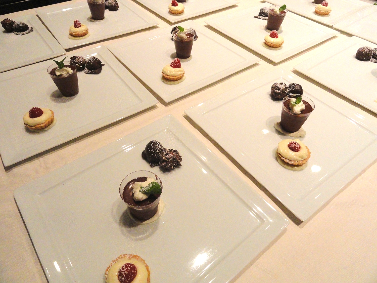 Chocolate trio: Chocolate pot de creme with minted cream, white chocolate mousse tartlet, chocolate champagne truffles