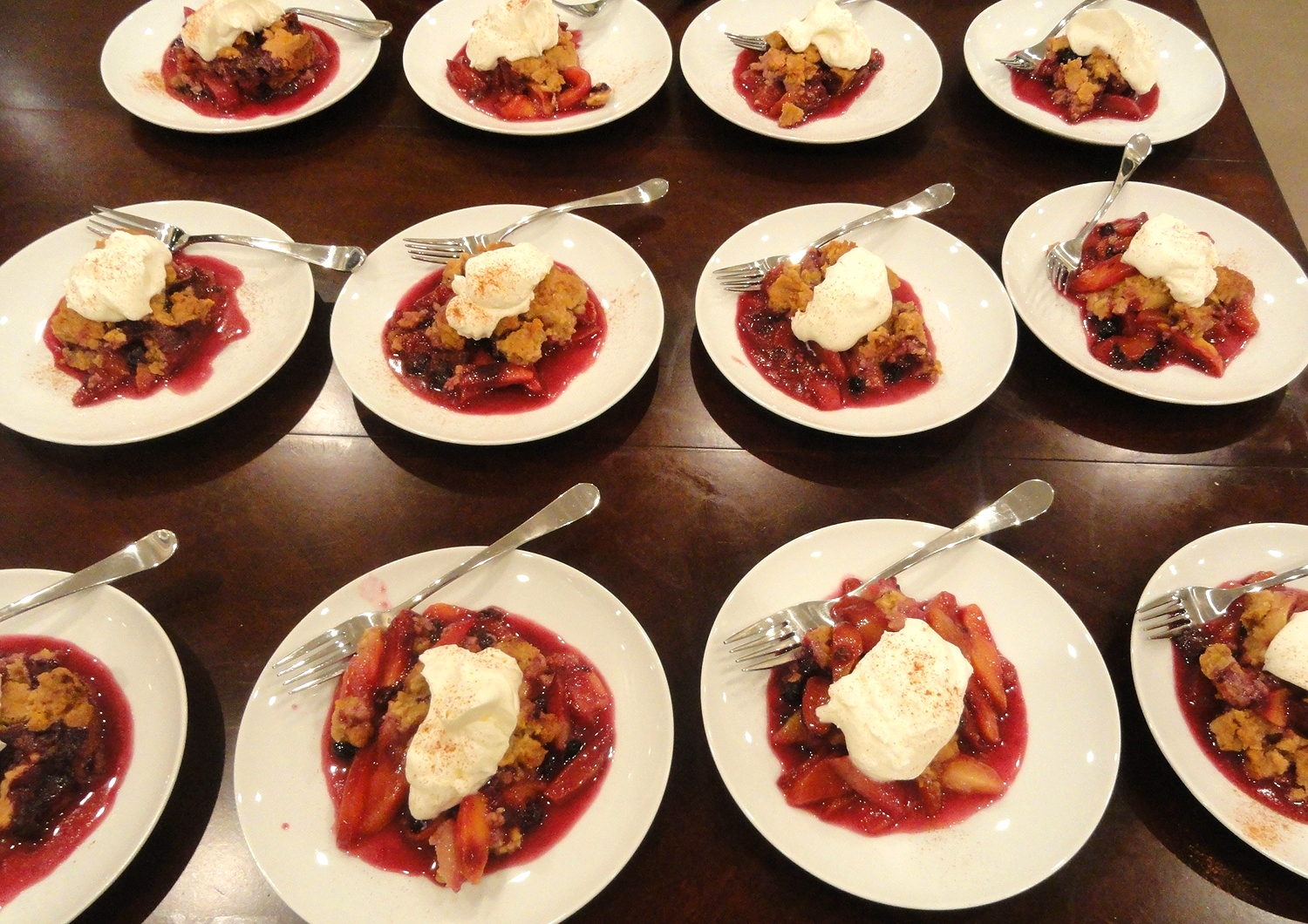 Warm summer stone fruit crisp with whipped cream