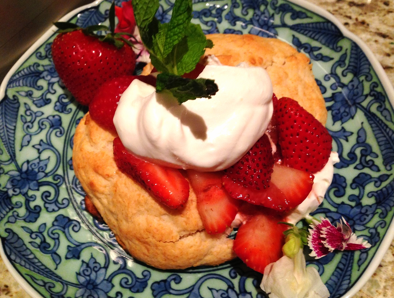 Strawberry shortcake with whipped cream and sliced strawberries