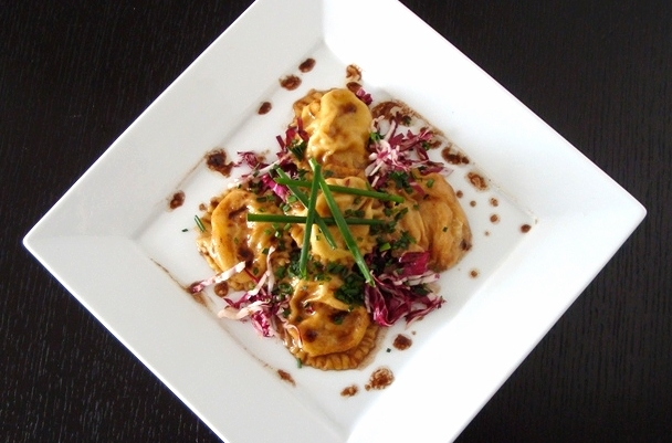 Homemade caramelized onion ravioli in a balsamic-butter glaze