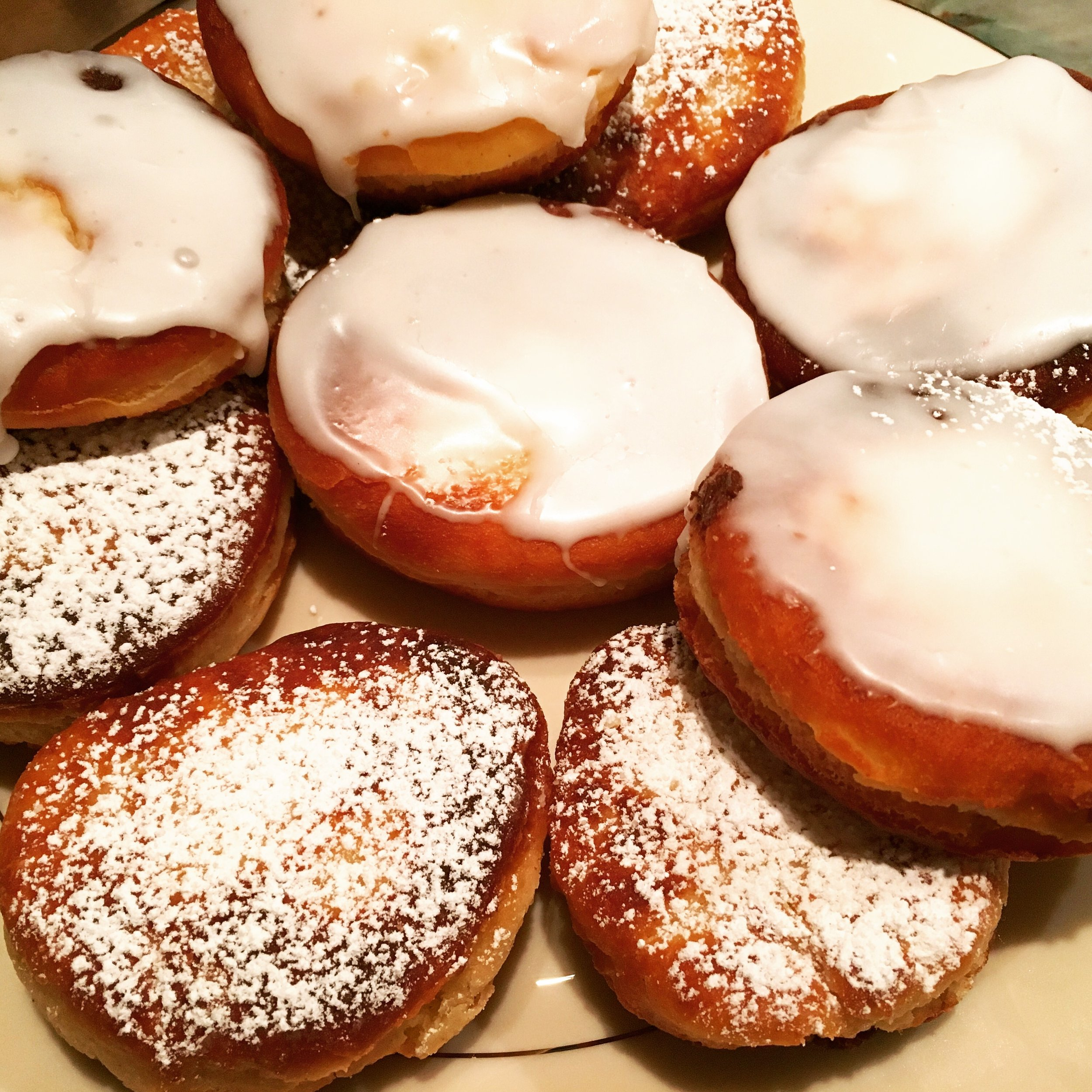 Above, sufganiyot I made with my family last Hanukkah: a culinary success but a mess getting my powdered sugar-covered nephew clean!
