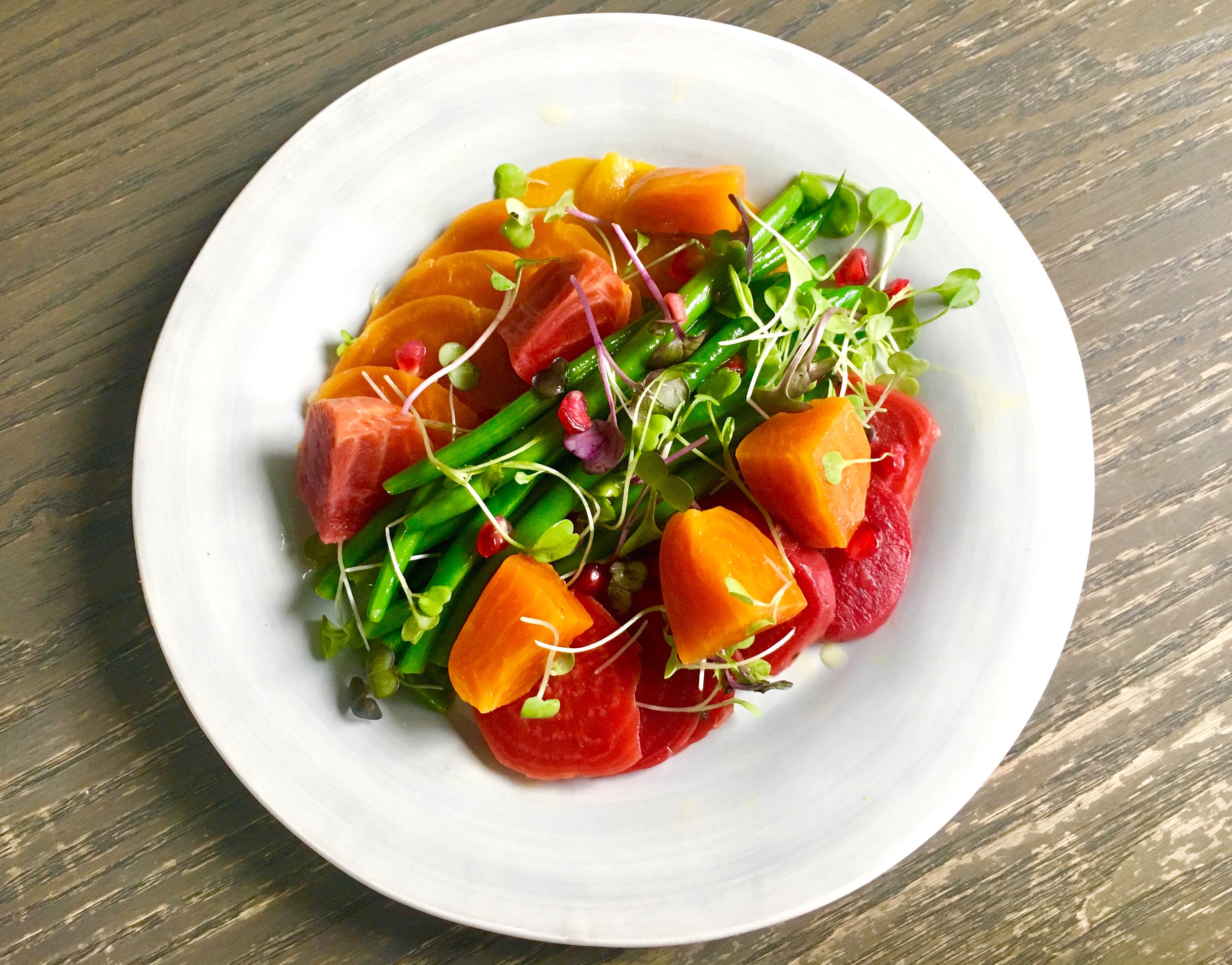 Golden and chioggia beet salad with haricot vert and microgreens
