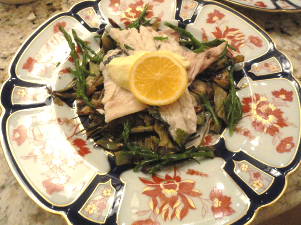 Branzino topped with meyer lemon aioli, over roasted artichokes and sea beans