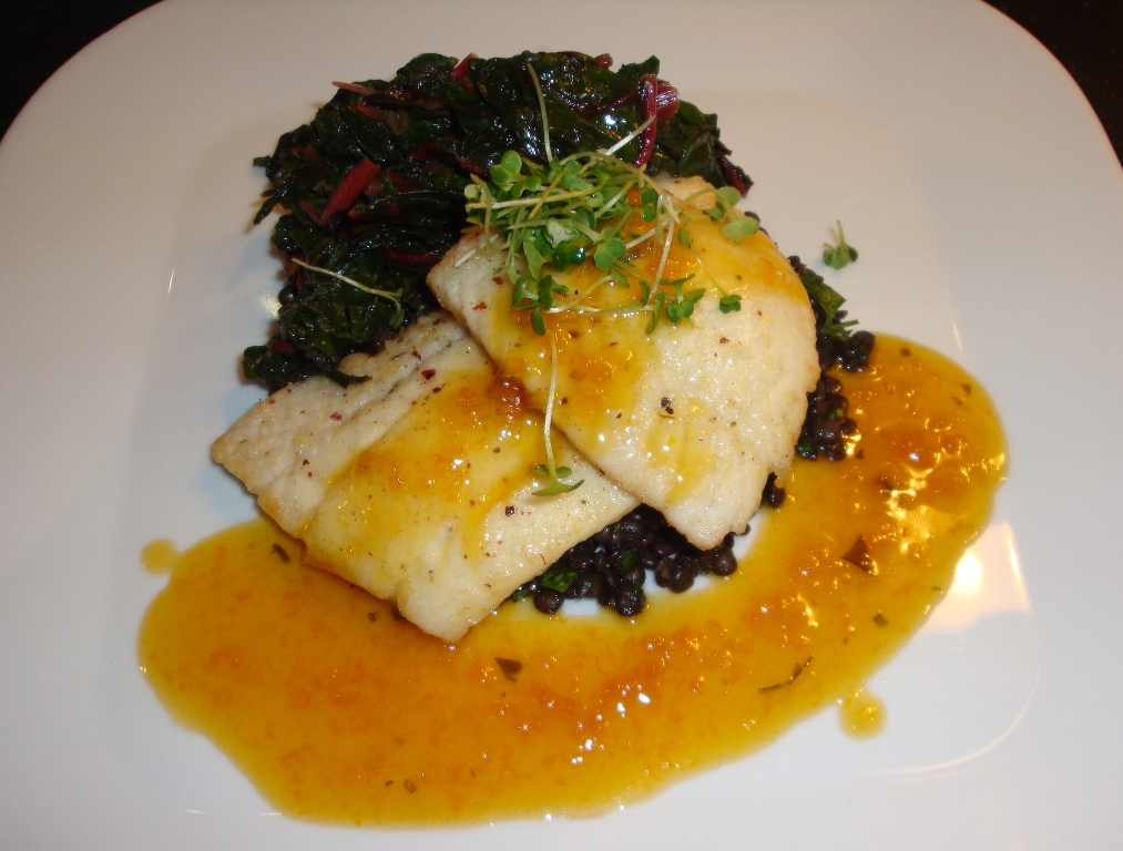 Lemon sole over beluga lentils and wilted chard, roasted citrus beurre blanc