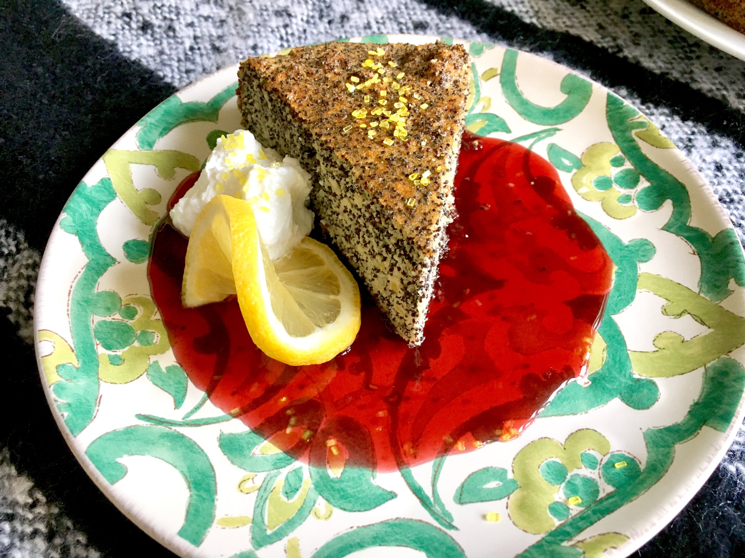 Rustic Italian flourless lemon-almond-poppyseed cake, four berry sauce, lemon sugar whipped cream