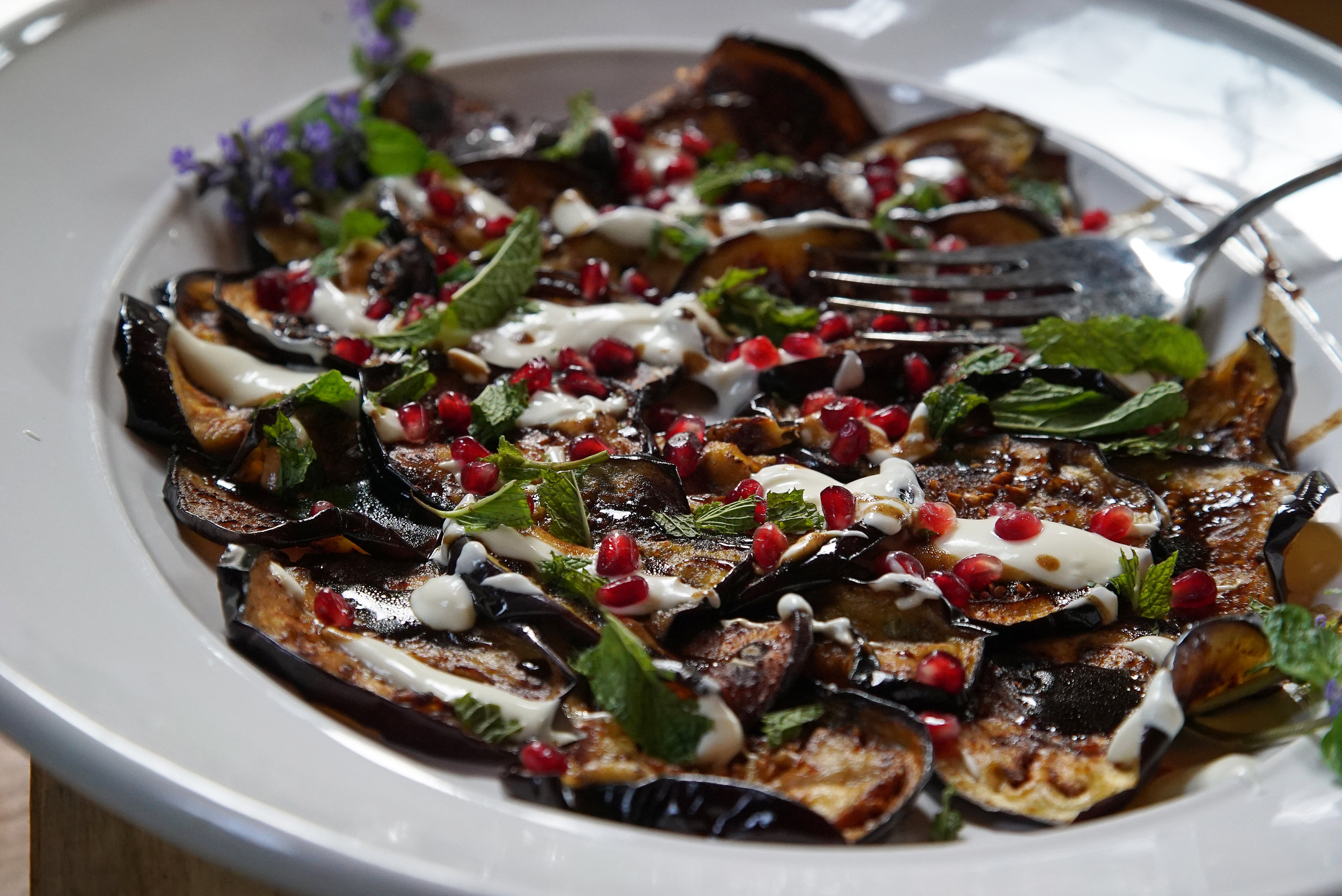 Lebanese eggplant with pomegranate and tamarind, yogurt, and mint