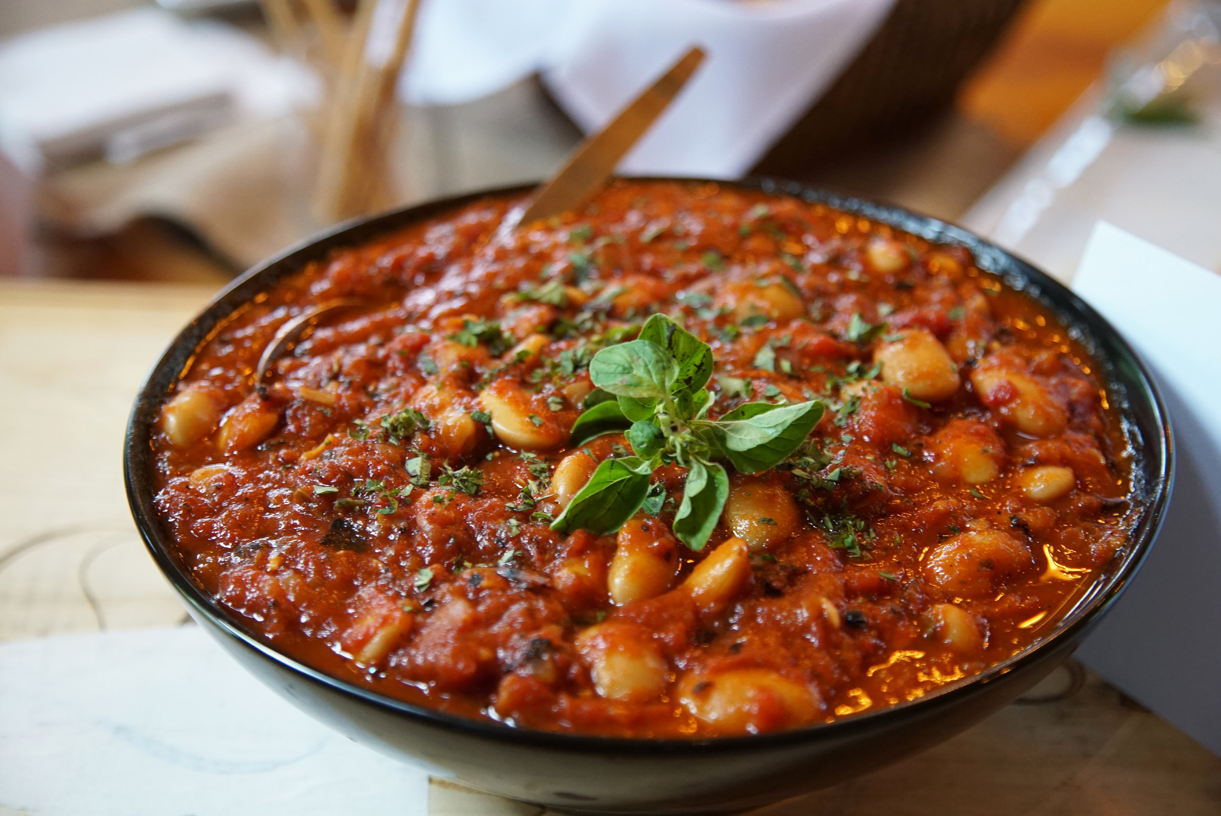 Koufounisi style stewed gigante beans with tomato, Greek oregano, and warm spices
