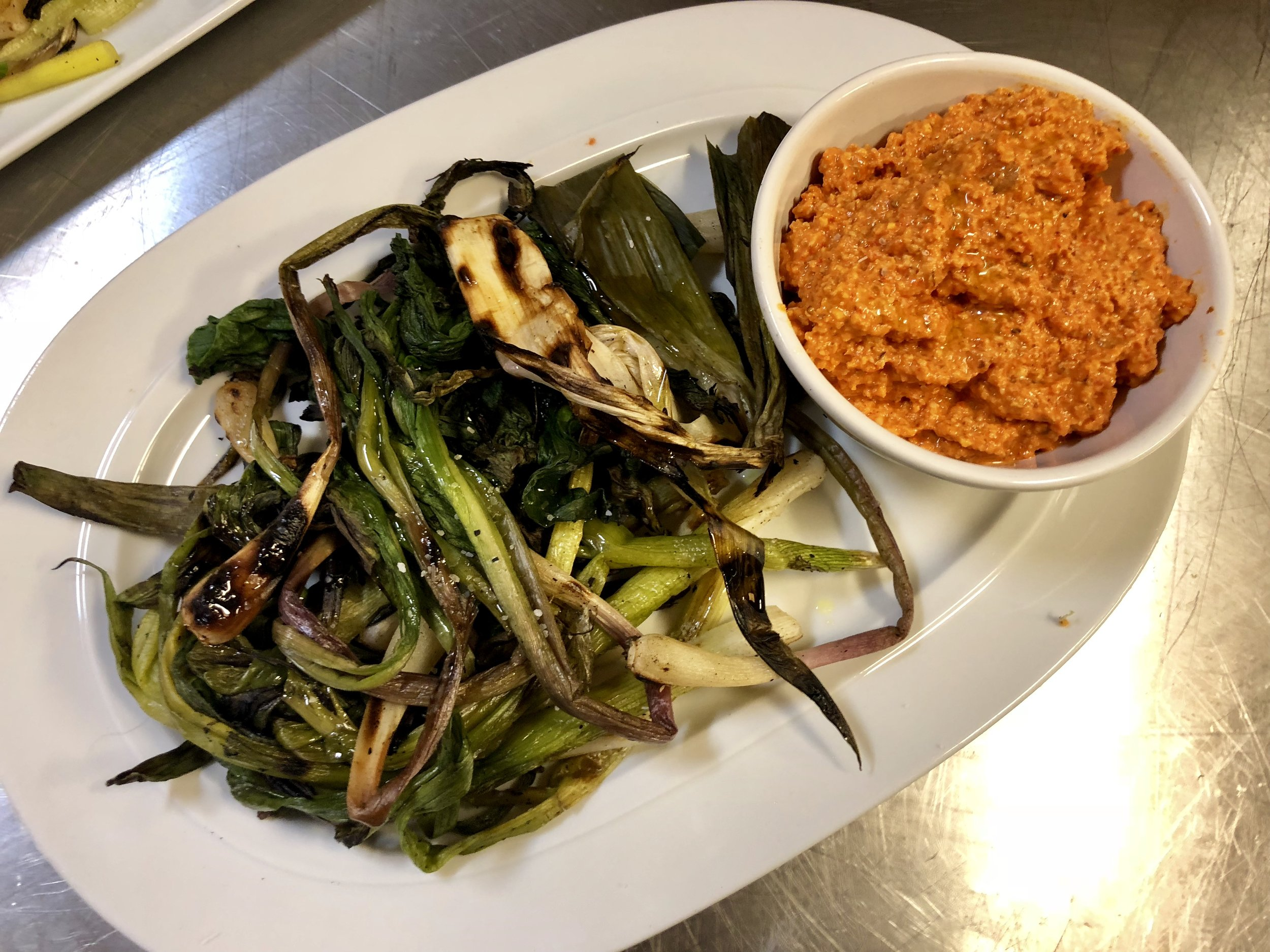 Grilled ramps, leeks, and scallions with Romesco sauce