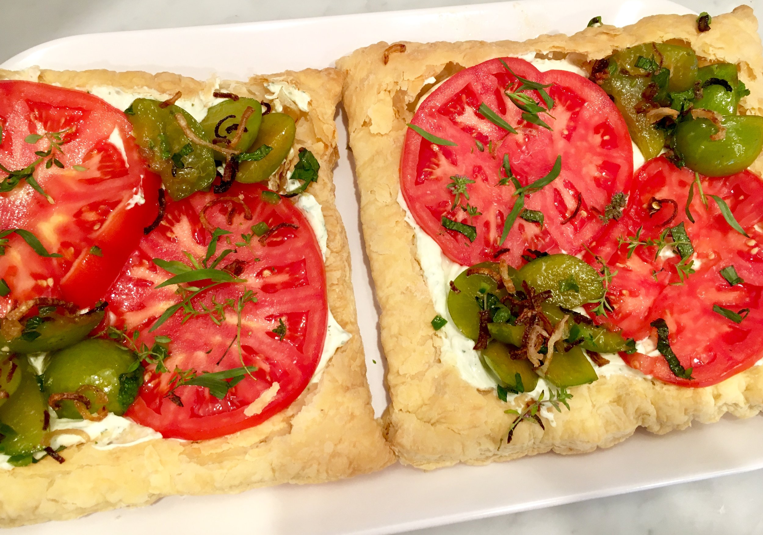 Heirloom tomato and green plum tart with herbed ricotta and fried shallots