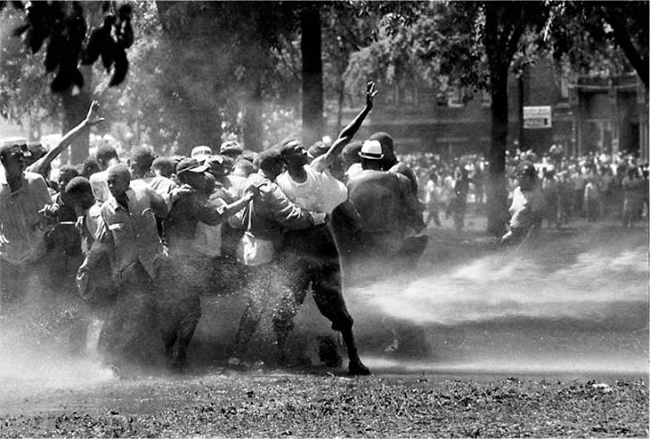 Firemen Turn High Powered Hoses Against Demonstrators in Kelly Ingram Park by Bob Adelman, 1963 (Birmingham, AL, USA)