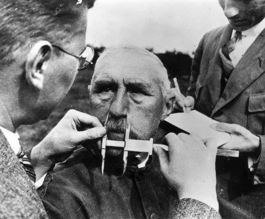 A Man Having His Nose Measured During Aryan Race Determination Tests in Nazi Germany (photo) by Henry Guttmann, 1940