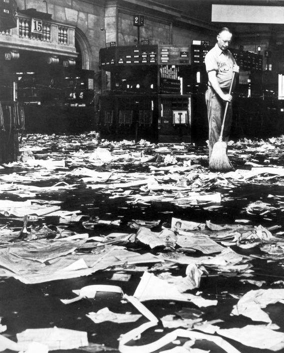 Man Sweeping Floor by New York Stock Exchange after Crash by Unknown, 1929