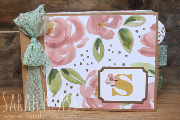 In this fun album project, the Kraft bags were used as album pages, alternating with different patterns of the    English Garden DSP    and stapled together at the left. The little tabs that are poking out on the right are attached to pieces of    Whisper White cardstock    that are added pages inserted into the bags.