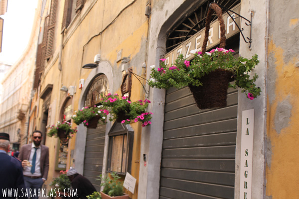 I have so many photos of alleyways in Italy! And pretty things like these hanging baskets
