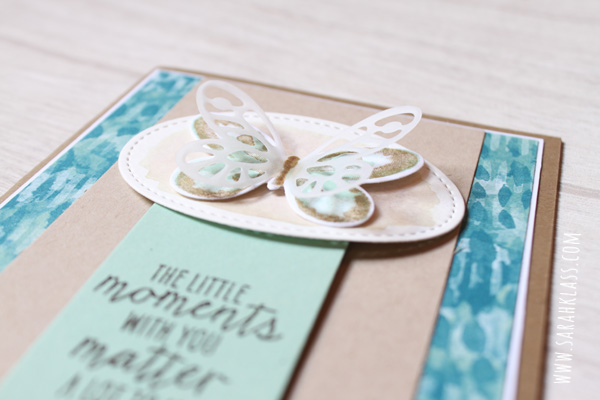 A delicate vellum butterfly adds interest and dimension and softens the colouring of the butterfly in the background