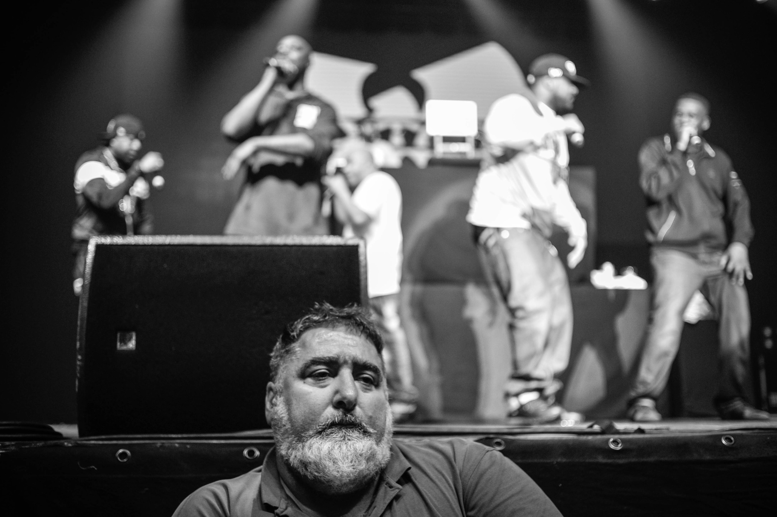 "A security man stands in front of the stage at the live concert of New York's Rap Crew ""Wu-Tang Clan"", 15 June 2015, Munich, Germany."