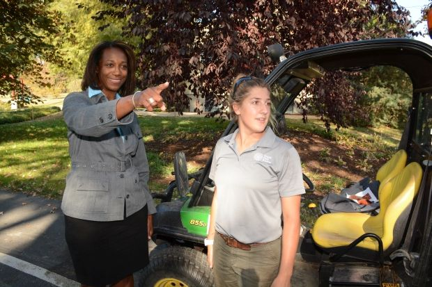 Tamara, working out in the field with Horticulturist Jaimie Tyler