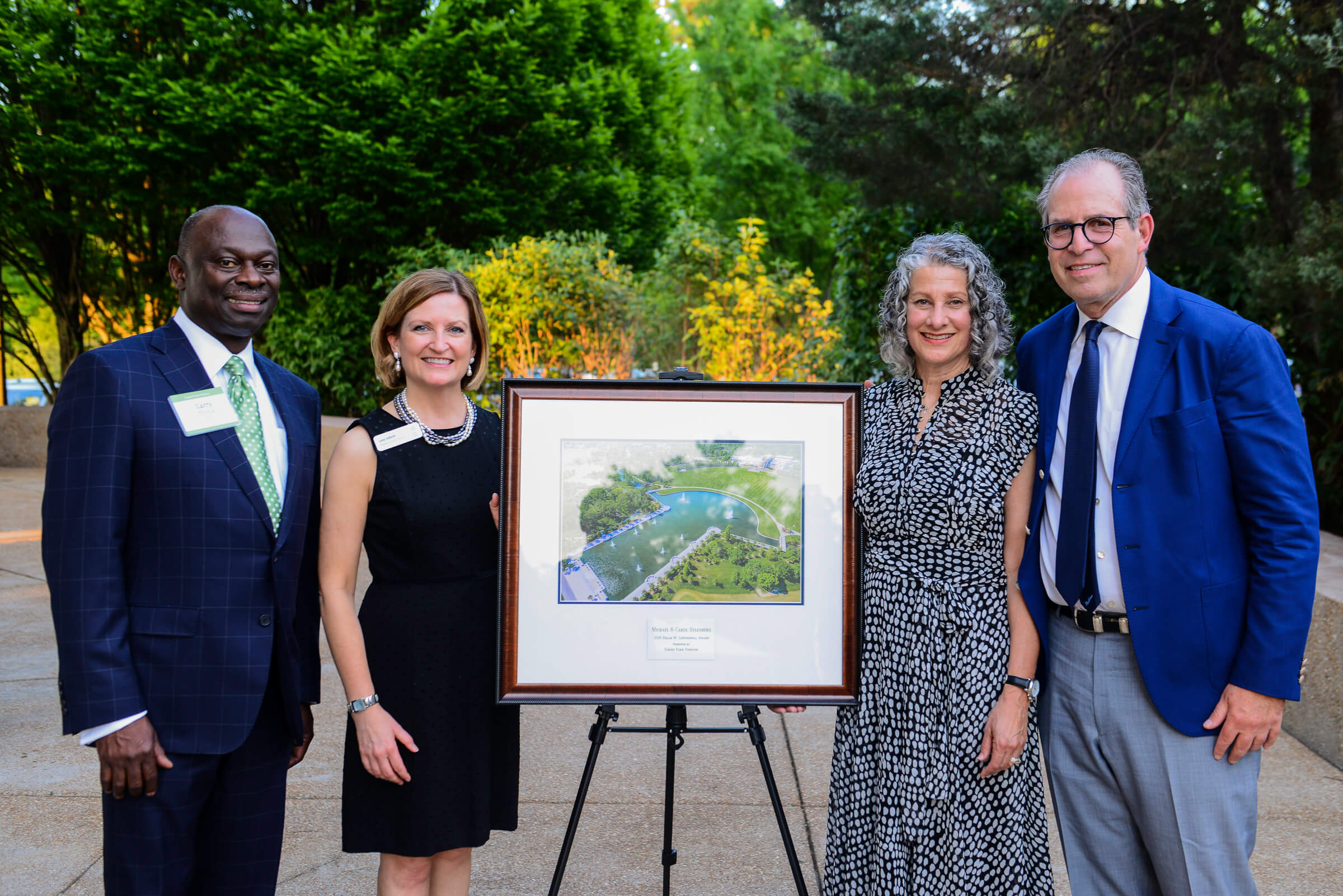 Pictured: Forest Park Forever Board Chair Larry Thomas, Forest Park Forever President and Executive Director Lesley S. Hoffarth, P.E., Carol and Michael Staenberg