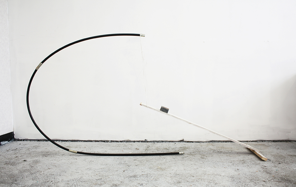 """""""Supportive Curve 1"""" (2014), Robyn Benson. Plastic, Brick, and Wood"""