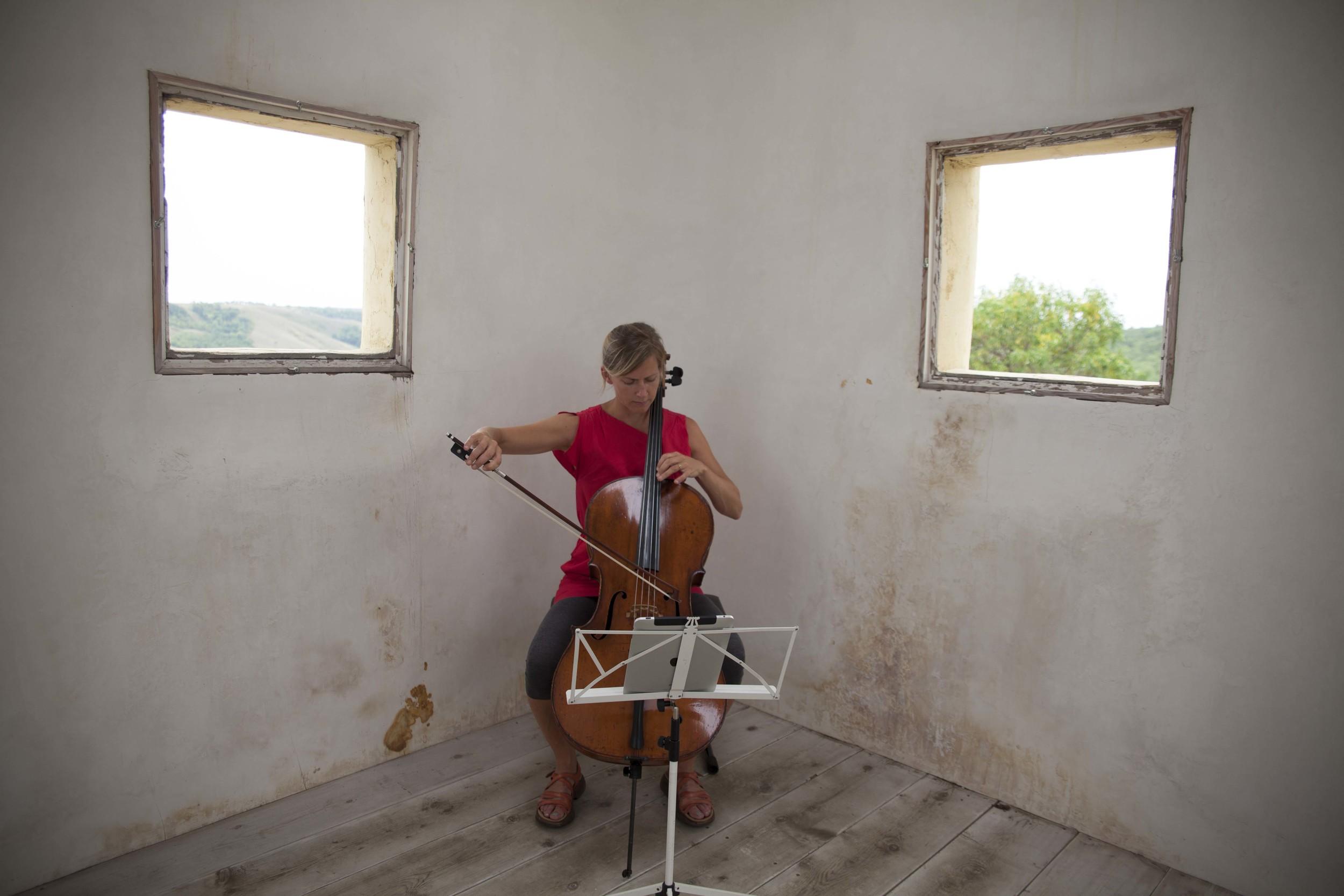"Odyssey Works' cellist Leanne Zacharias  performing ""When I Left the House it Was Still Dark"" in Saskatchewan, Canada, in 2013. Photograph by Ayden L. M. Grout"