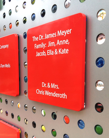 Donor names are presented on colorful shapes that can be removed for easy updating.