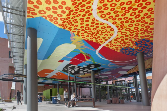 """Curtin partnered with local independent, non-profit cultural organization FORM to bring an international ""who's who"" of urban artists to the campus as part of PUBLIC2016. This mural is by American artist HENSE, painted on the ceiling of a new building on campus 