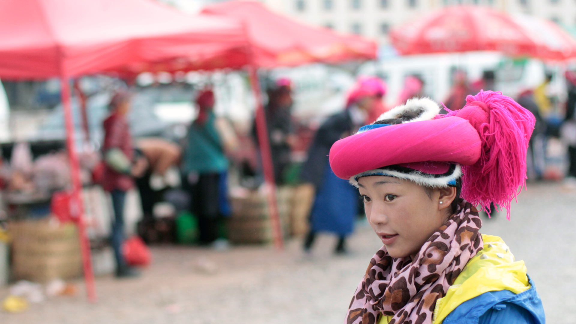 A TIBETAN GIRL IN THE MARKET