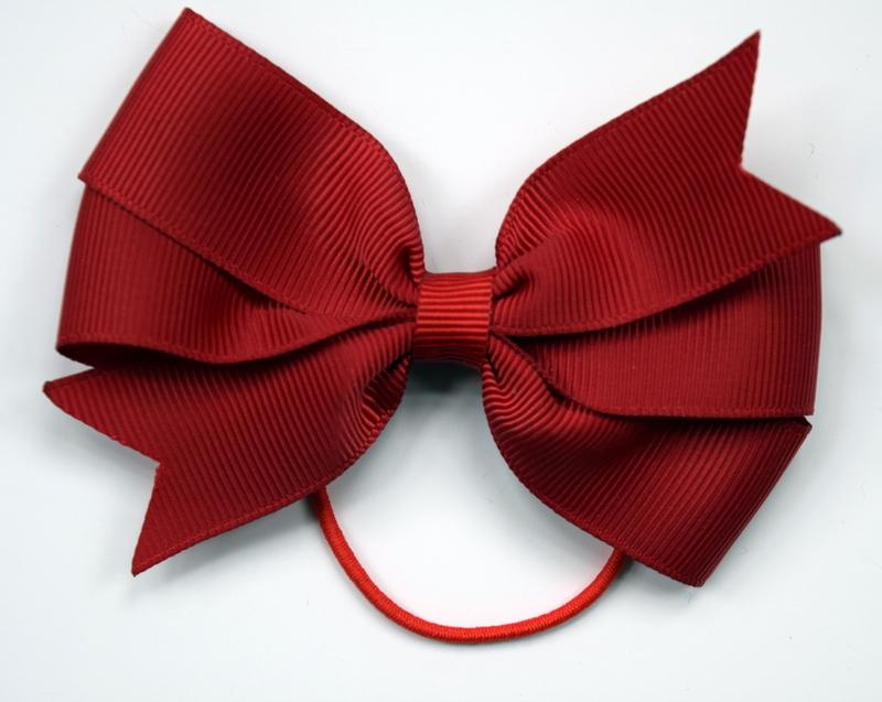 Medium red bow on a hair elastic £3