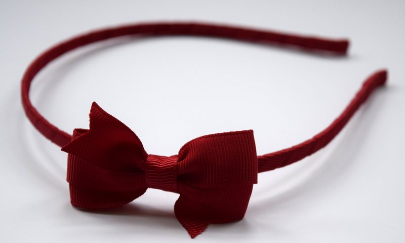 Hairband with small red bow