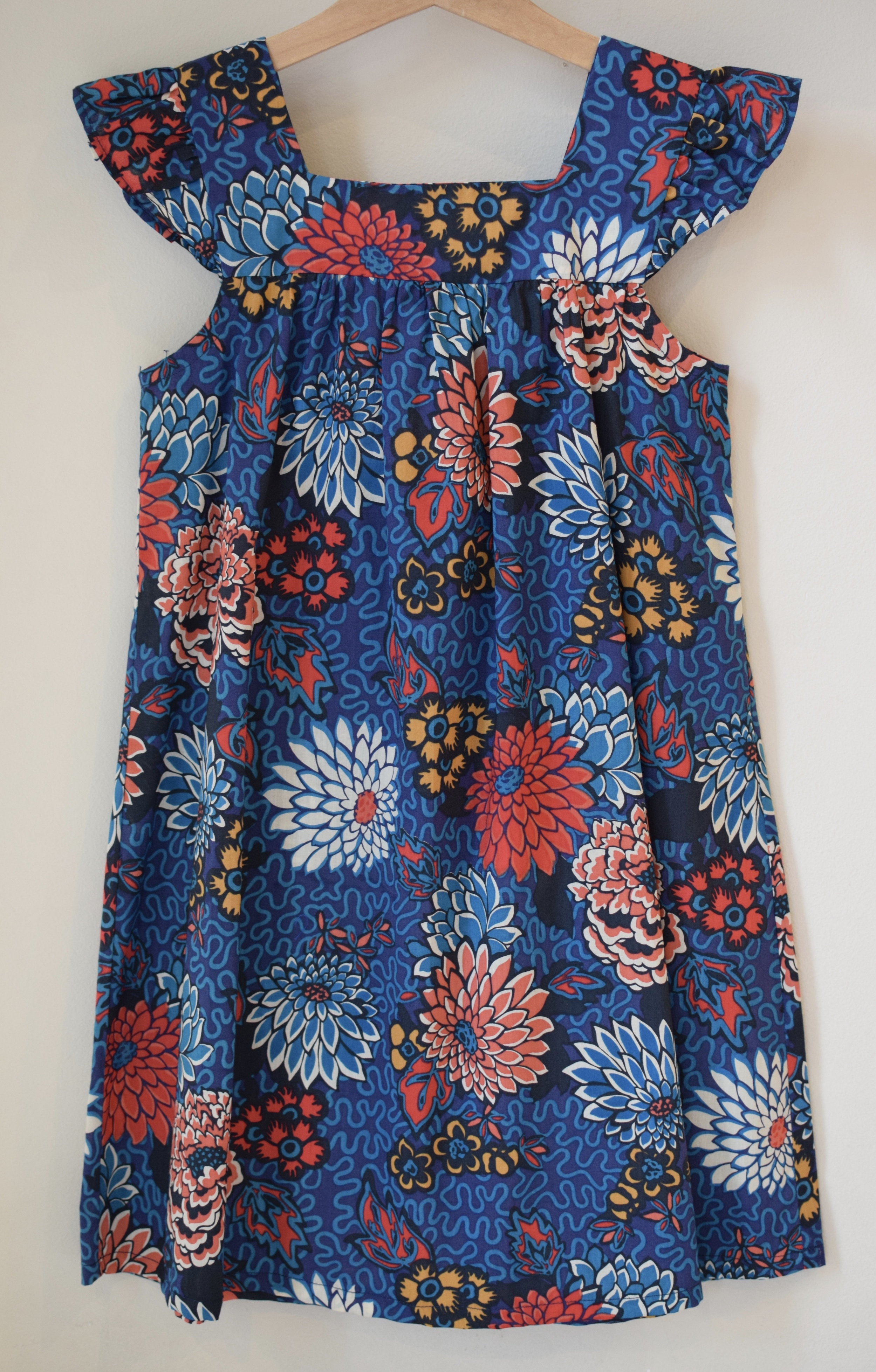 Meandering Chrysanthemums red and blue Dress £43    Liberty print dress with ruffle sleeves and square neck detail. Available exclusively in size 6y  .