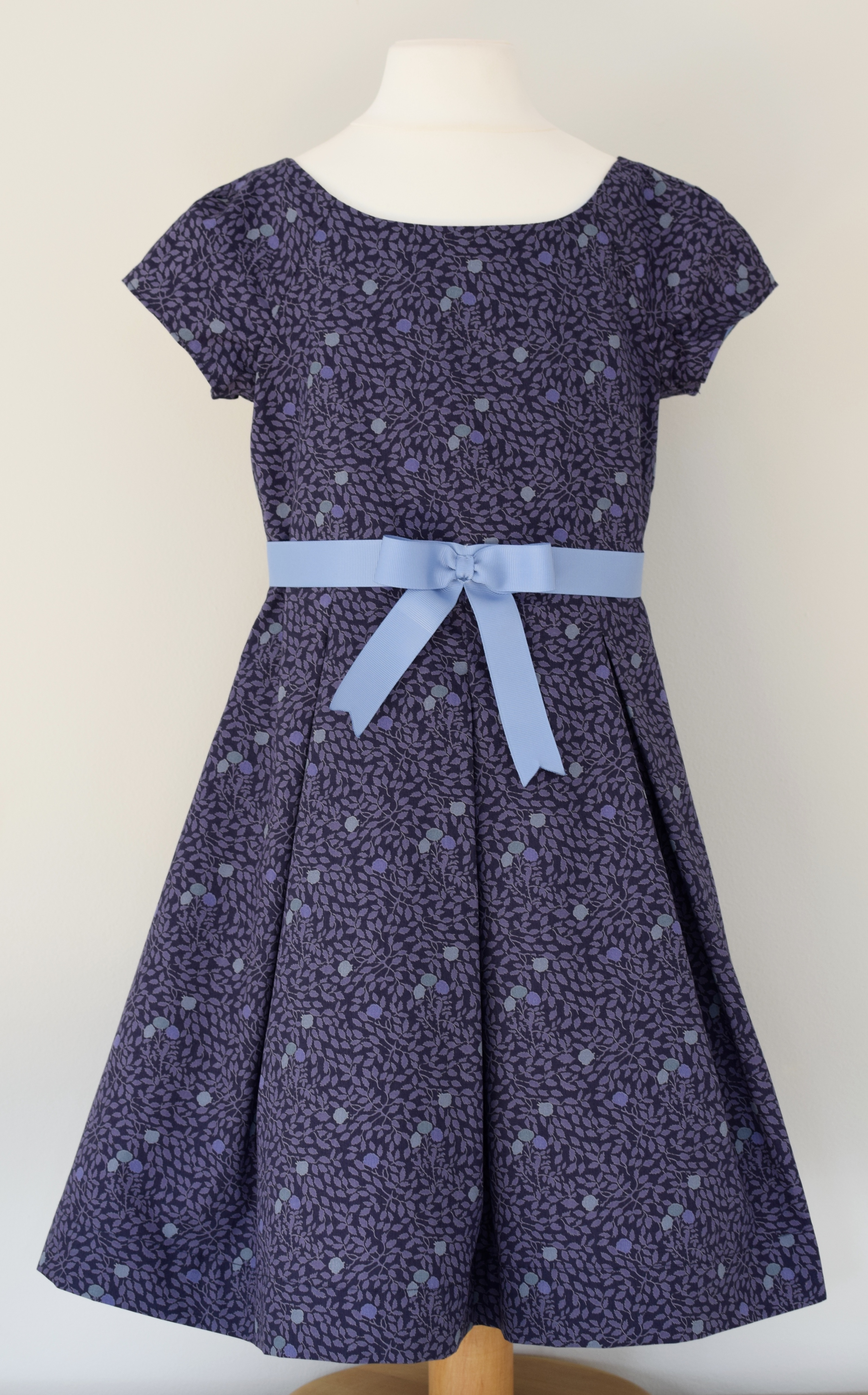 Isla Jane party dress £43   Liberty print party dress: fully lined with cap sleeves, fixed grosgrain ribbon and a concealed zip at the back. Available exclusively in size 5y.