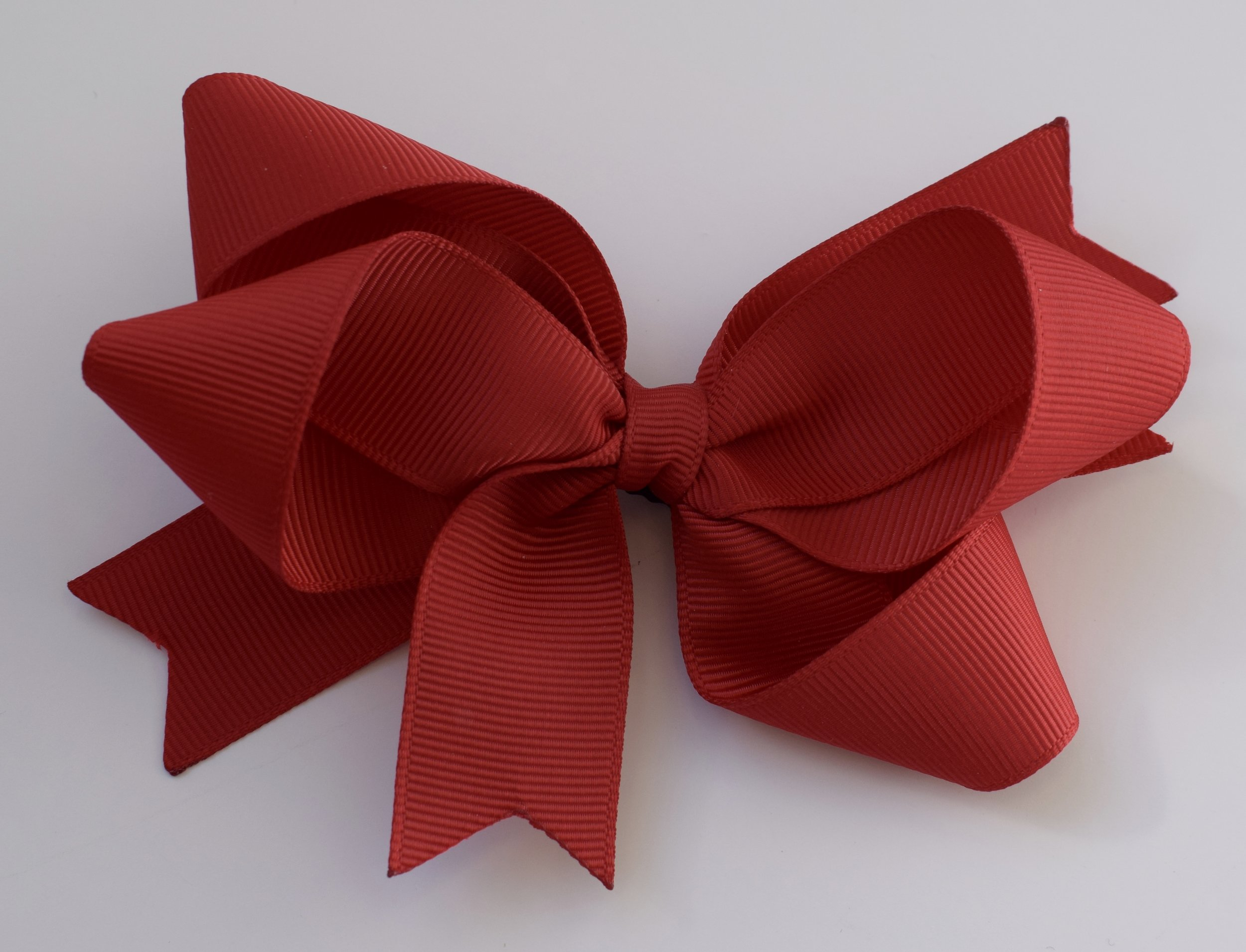 Matching red hair bows in a variety of sizes from £3