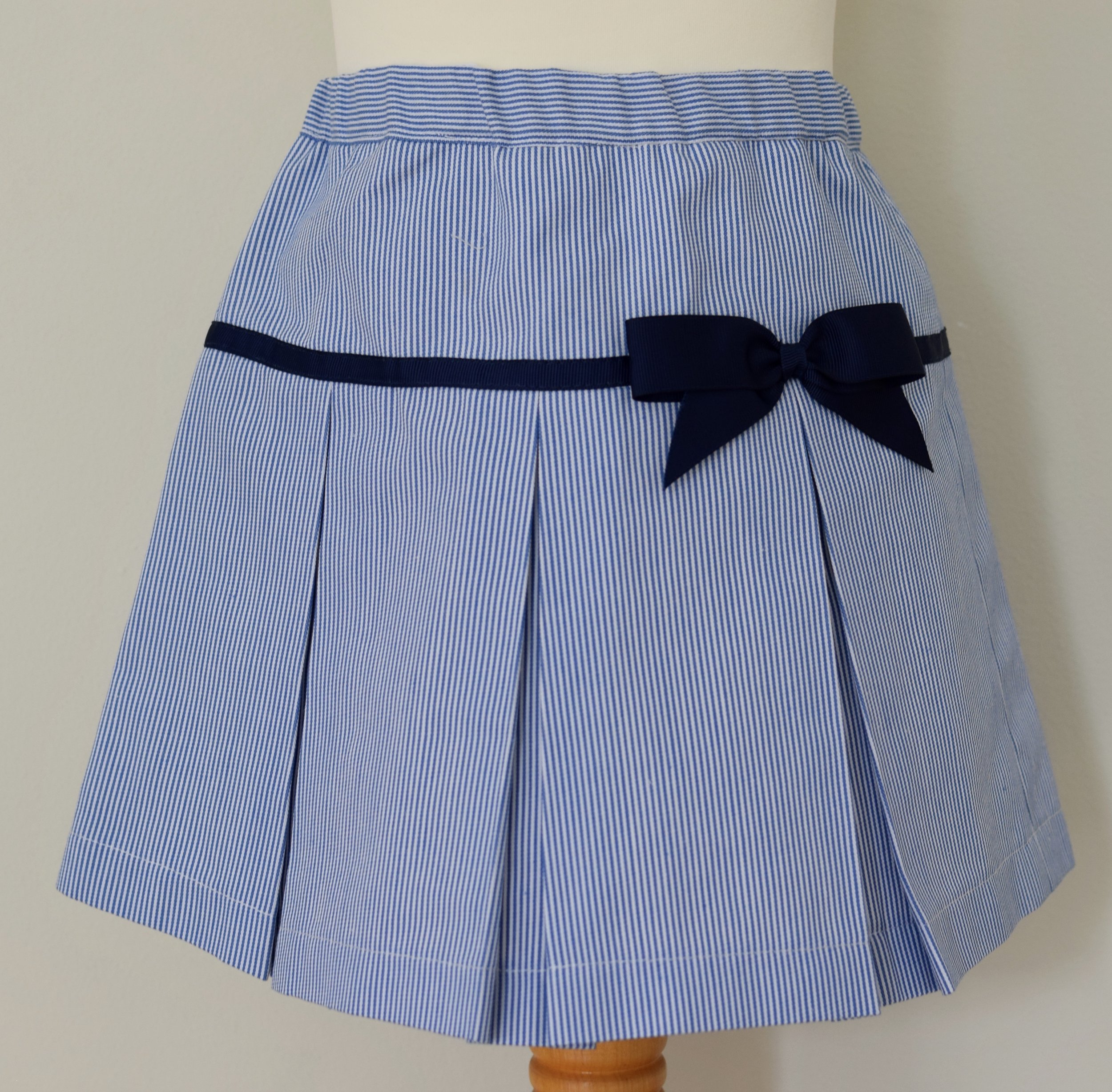 Ticking stripe pleated skirt with an elasticated and adjustable waist, fixed navy grosgrain ribbon.  £25