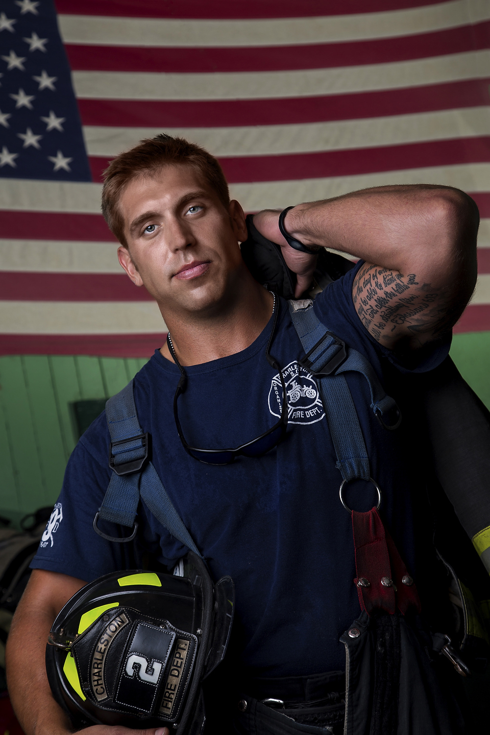 A fireman with the Charleston fire department poses for a portrait.
