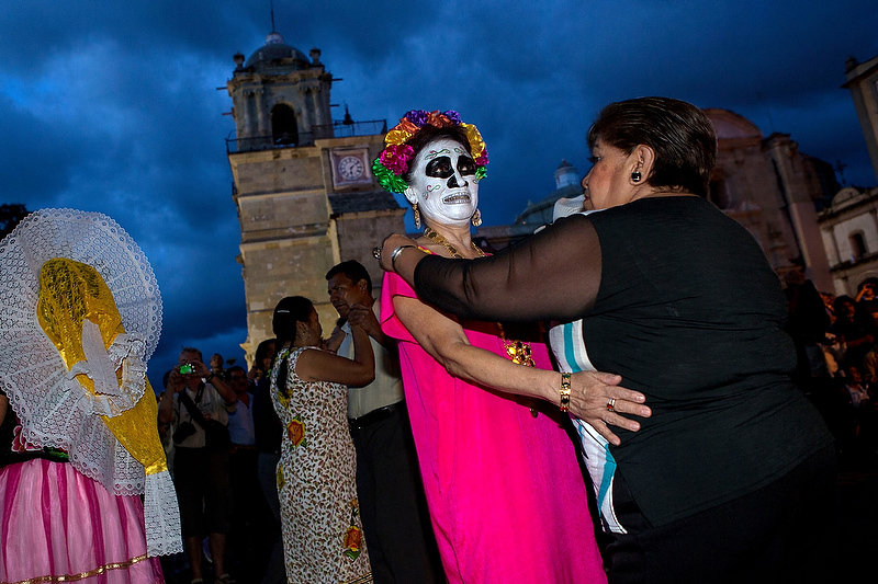 Revelers dance in the town square in traditional costumes at the start of the Day of the Dead festival known in spanish as Día de Muertos October 30, 2013 in Oaxaca, Mexico.