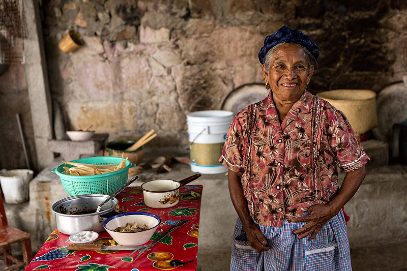 An elderly Zapotec indigenous woman poses in her kitchen in Teotitlan, Mexico.