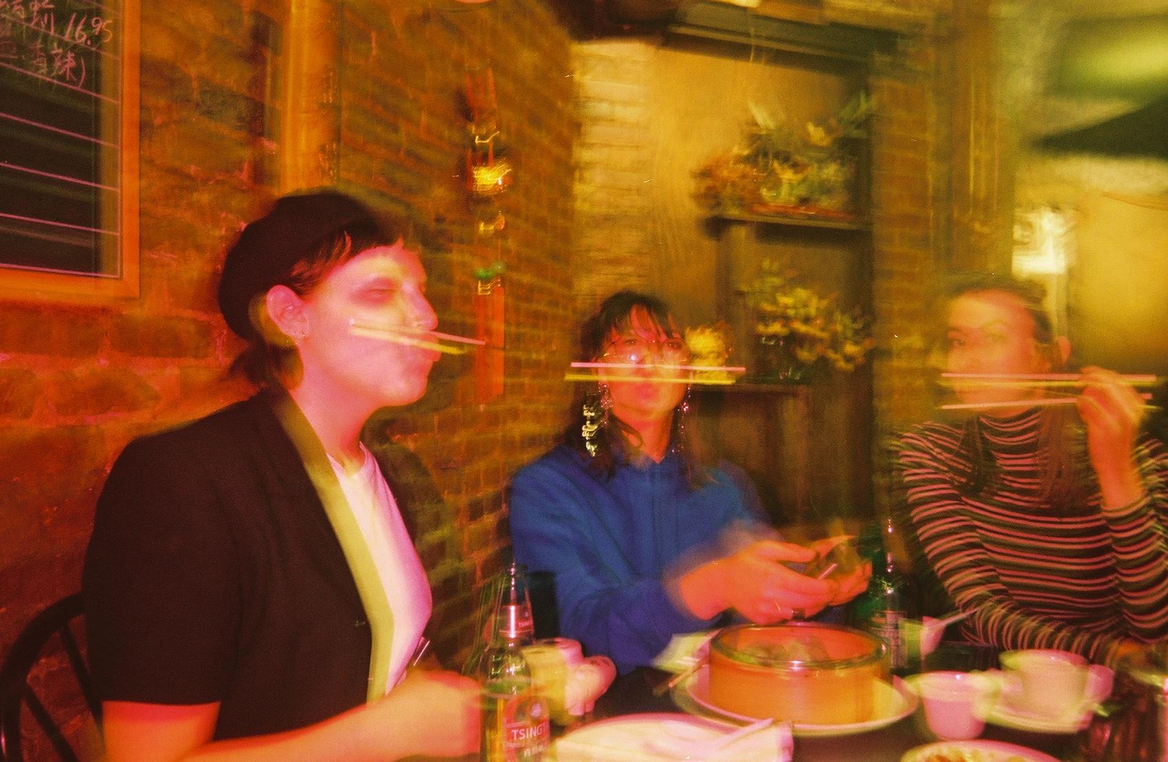 Abby, Lin, and LP performing a very original chopsticks trick.